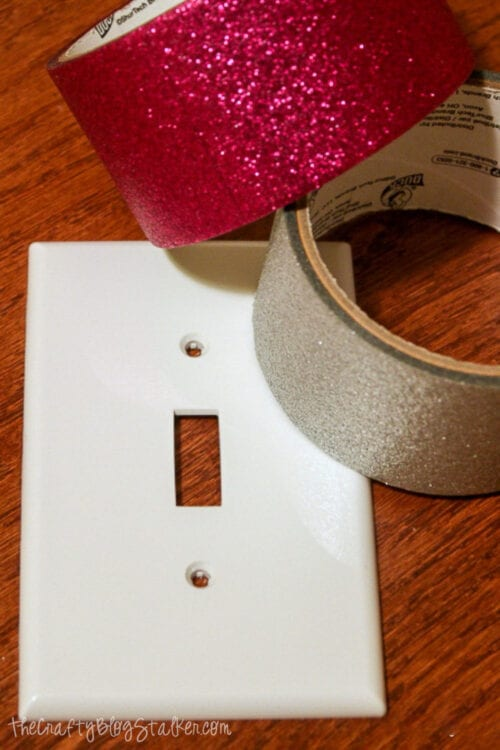 pink and silver glitter duck tape and a white light switch cover plate