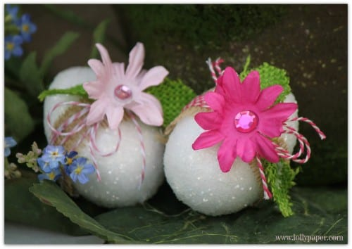 easter eggs decorated with white glitter, silk flowers and burlap