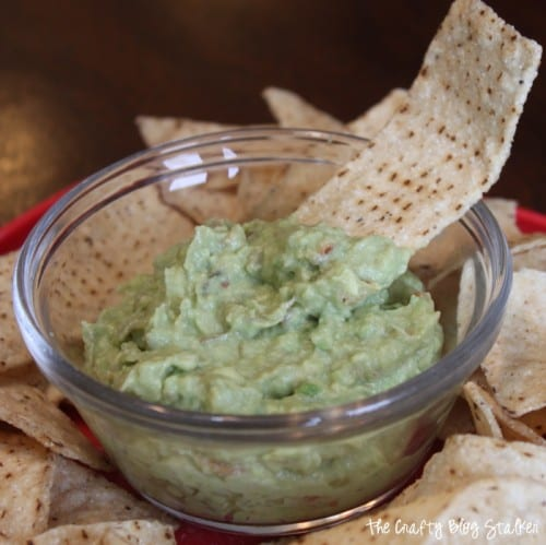 a bowl of the best guacamole dip and tortilla chips