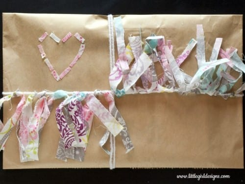 a gift wrapped with kraft paper and fabric bunting