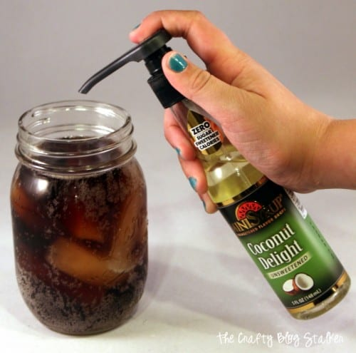 adding soda flavor shots to a mason jar of diet pepsi