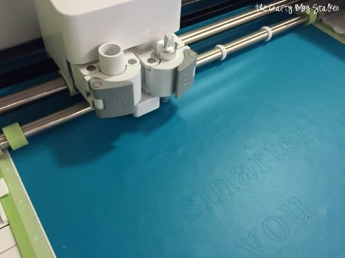 Cricut explore cutting out blue vinyl for a mirror decal