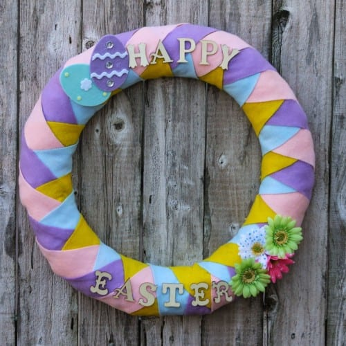 diy felt easter wreath made with pink, purple, blue and yellow craft felt