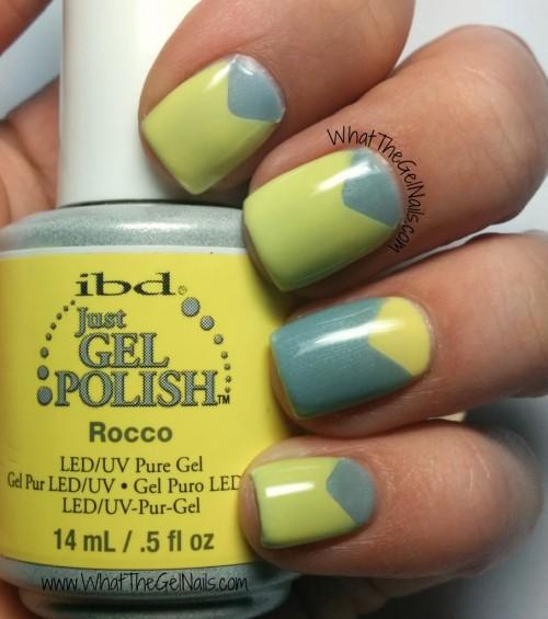 manicured nails holding a gel nail polish bottle
