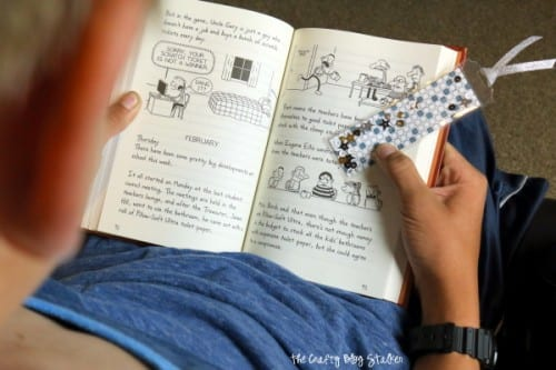 a child reading holing his shaker bookmark