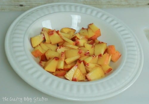 image of a cut up peach in a bowl