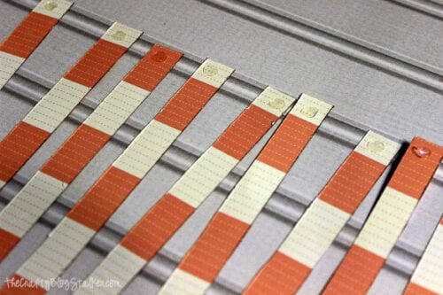 glue dots on the ends of strips of paper