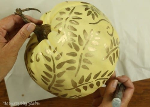 a finished painted pumpkin with vines