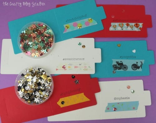 adding sequins to the front of each card