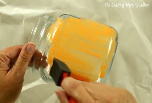 painting the glass jar with orange gallery Glass Paint and a sponge brush