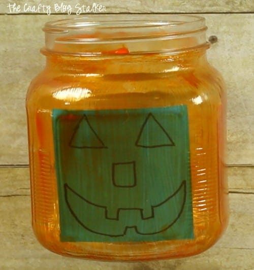 sticky note inside the jar to trace for the jack o lantern face
