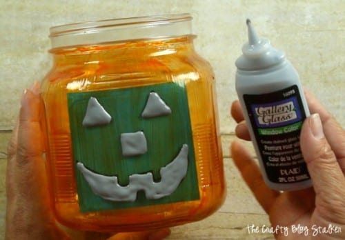 How to Make a Painted Glass Pumpkin Jar, a tutorial featured by top US craft blog, The Crafty Blog Stalker