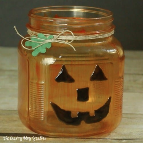 finished glass painted pumpkin jar