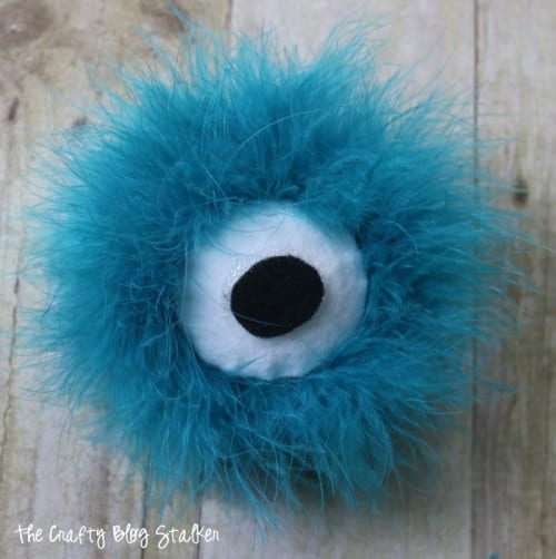 Craft a fun fluffy monster eyes headband to wear trick or treating. Great for kids and adults! An easy DIY costume that is perfect for Halloween #MakeItFunCrafts #ad