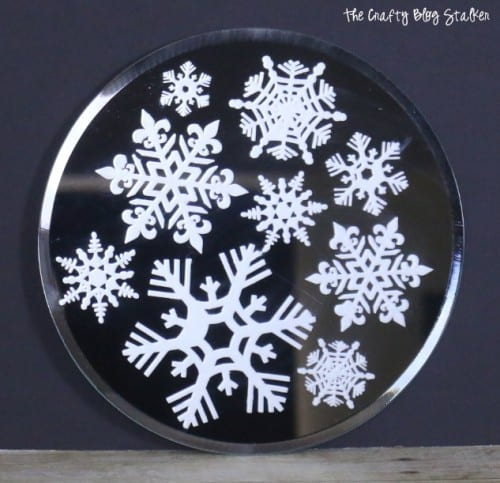 Create a beautiful glass etched snowflake candle mirror plate. Adorn with LED Candles and you have a simple centerpiece for the perfect home decor piece.