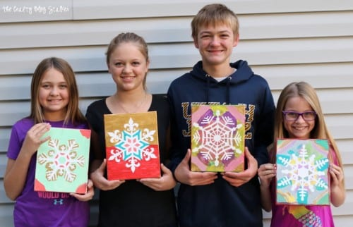How to Make a Snowflake Finger Painted Canvas, a tutorial featured by top US craft blog, The Crafty Blog Stalker.