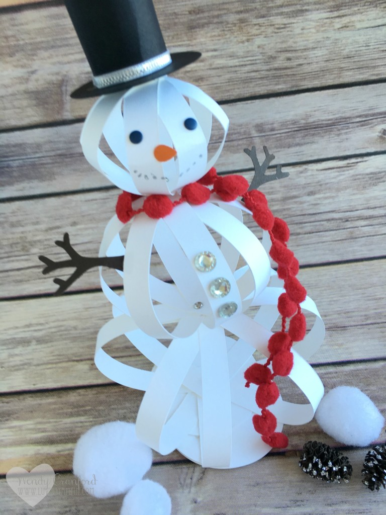 how to make a snowman craft with paper strips the crafty