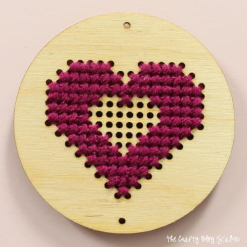Learn how to make the Sew Much Love craft kit from Apostrophe S. An easy DIY jewelry tutorial idea for a cross-stitch heart pendant necklace.