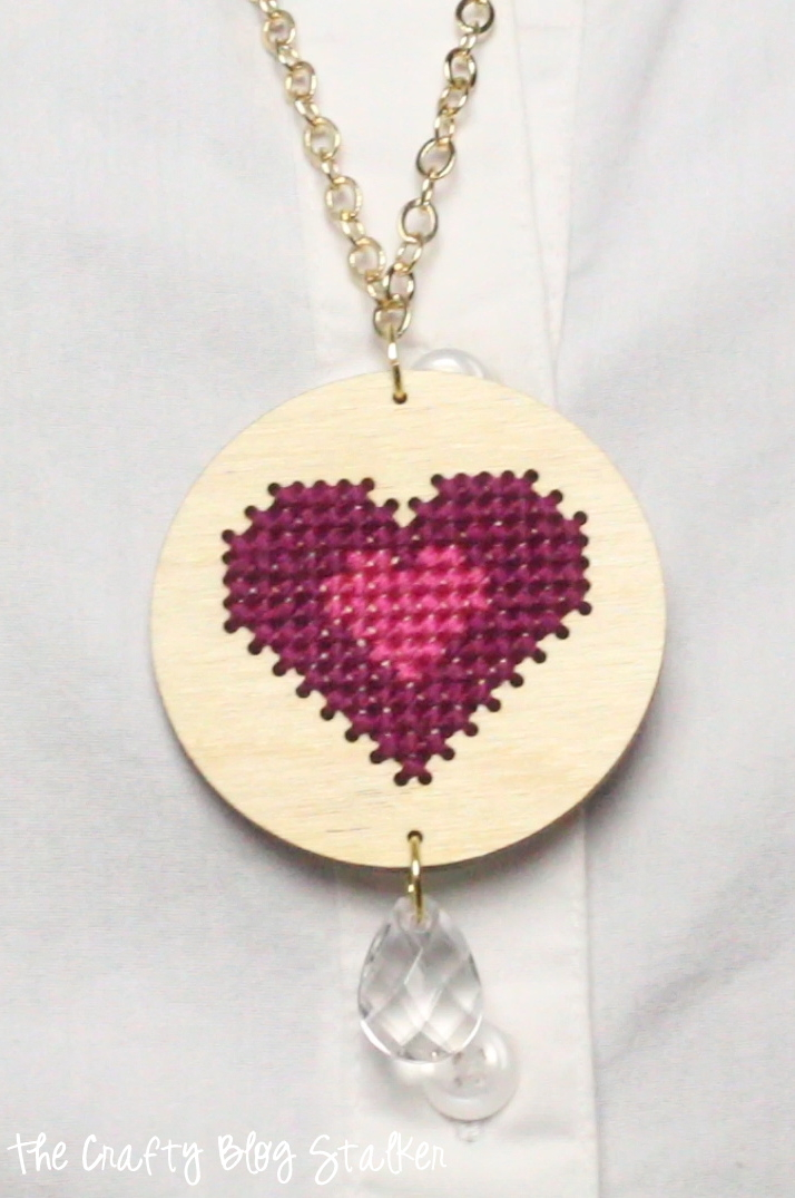 Add a unique piece of DIY Jewelry to your collection. A simple cross-stitch pendant will add beautiful style to your collection.