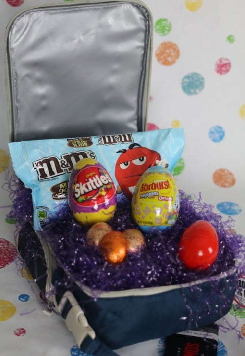 a lunch box filled with candy to make an Easter basket
