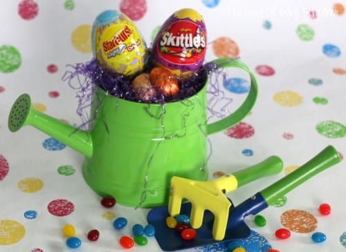 a toy watering can filled with Easter candy
