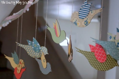 Hanging Bird Garland from the Flock Together Apostrophe S Craft Kit. Easy DIY craft tutorial idea for home decor, nursery decor or party decor.
