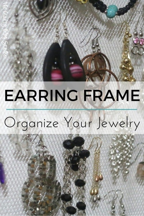 Earring Holder Frame | a close up of a mesh earring holder frame with earrings