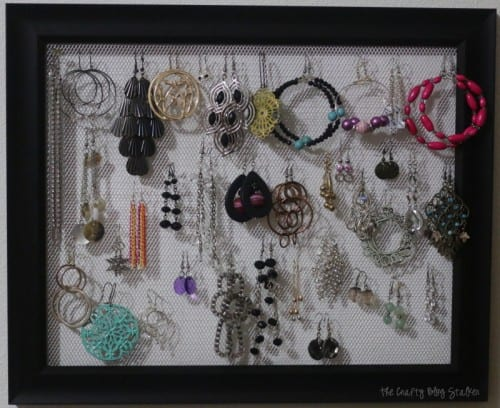 Earring Holder Frame | the finished mesh earring holder frame with earrings hanging from it