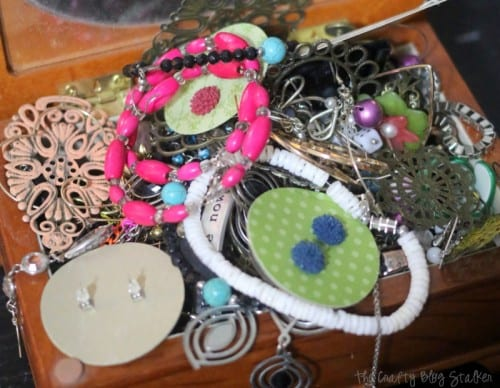 Earring Holder Frame | unorganized earrings in a messy pile