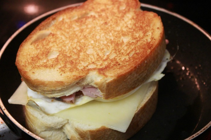 Ham and Egg Grilled Cheese cooking