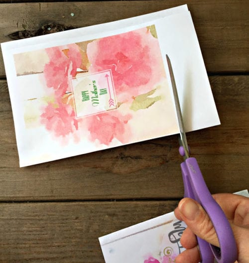 trimming the mother's day card with a pair of scissors