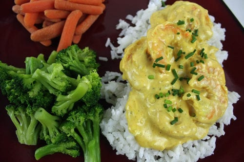 Shrimp Curry over rice looks and tastes delicious, and is one of the quickest and easiest dinners to make! Honestly, it will take longer for the rice to cook than it will to make the rest of the meal.