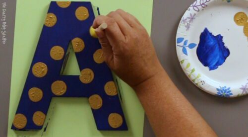 adding gold polka dots with gold paint