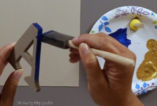 painting the edge of a monogram letter