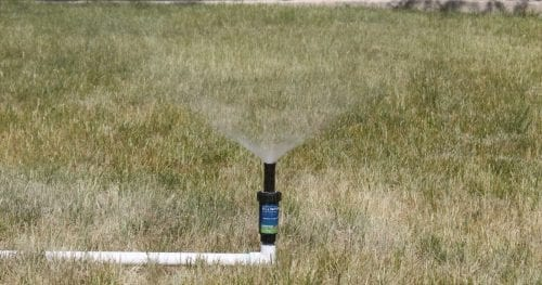 Make a simple and inexpensive DIY above-ground sprinkler system made from PVC Pipe. Water your lawn in half the time without a sprinkler system. Enjoy your green lawn.