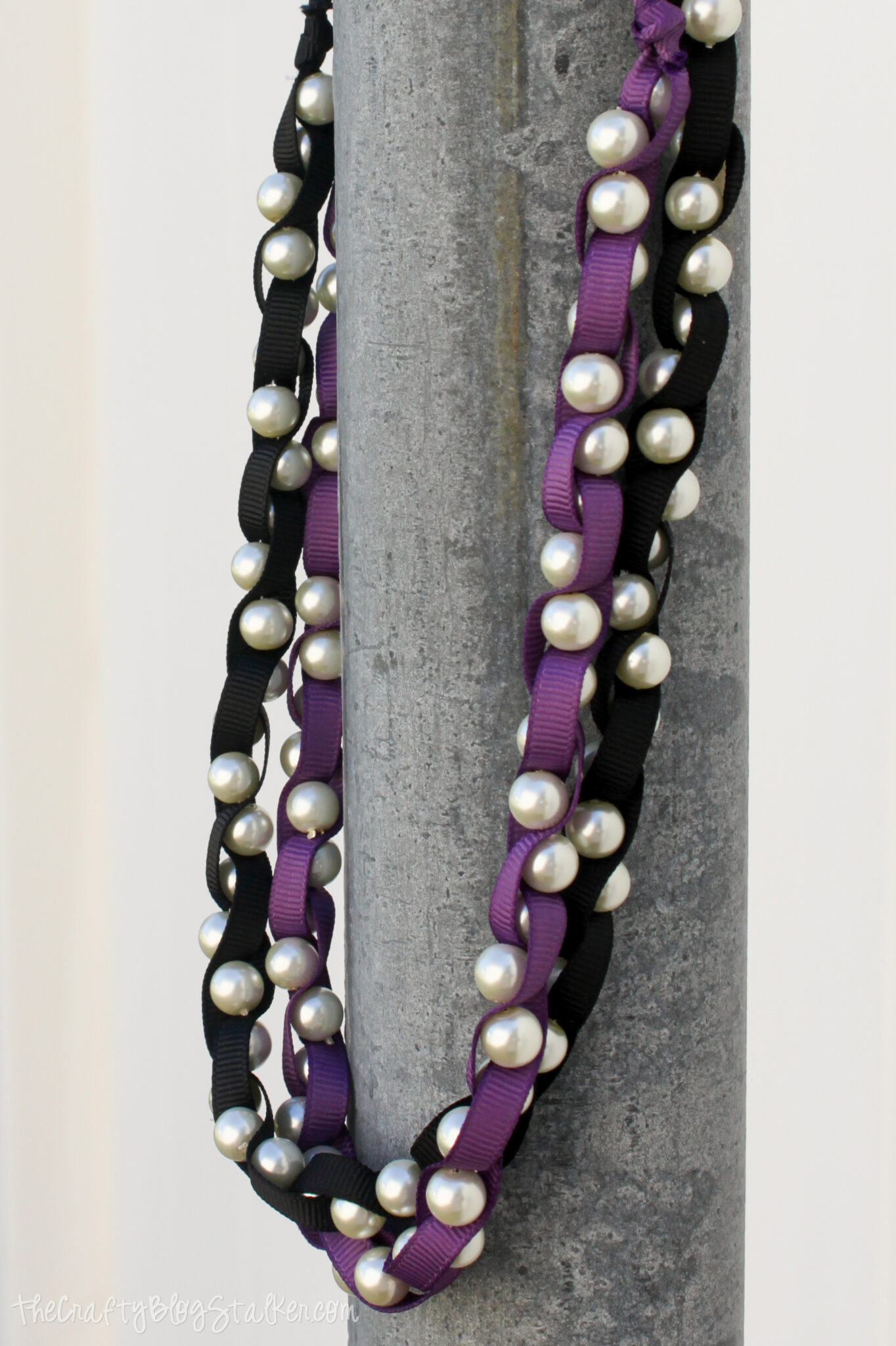 two braided pearl necklaces