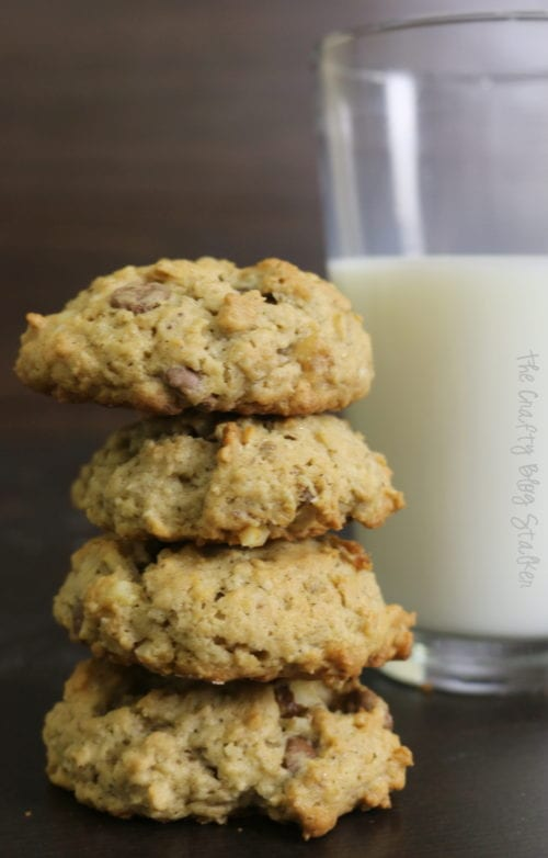a stack of oatmeal chocolate chip cookies and a glass of milk