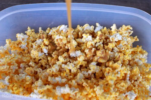 pouring the caramel sauce on the popcorn