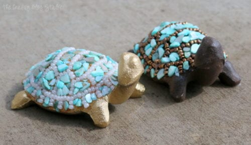 a pair of beaded turtle home decor
