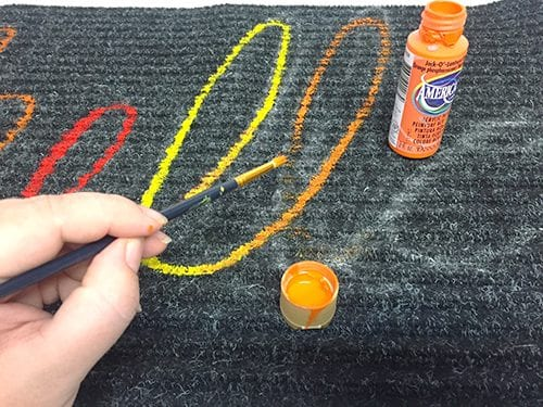 "Use a Dollar Store Rug and some acrylic craft paint to make an adorable custom Autumn ""Hello"" rug in less than an hour. An easy DIY craft tutorial idea."