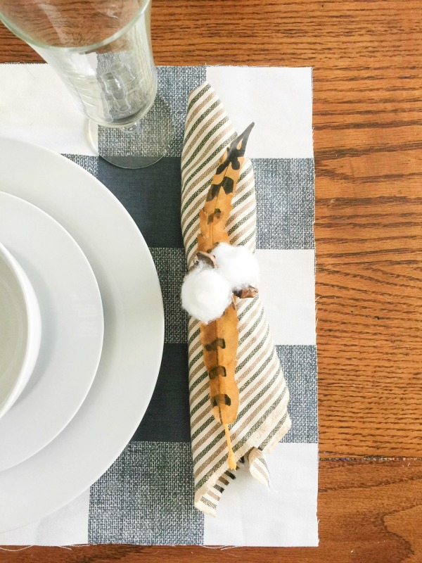 Do you love cotton stem decor? Why not try these cotton stem napkin rings. An easy DIY craft tutorial idea perfect for your Thanksgiving table this fall!