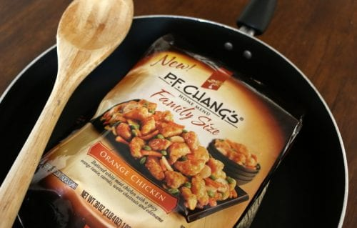 P.F. Chang's Home Menu frozen meal in the package in a pan with a wood spoon