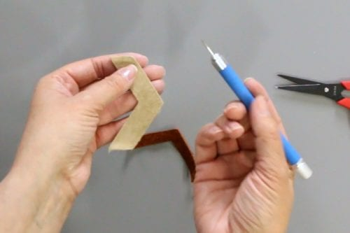 image of piercing the leather with an awl