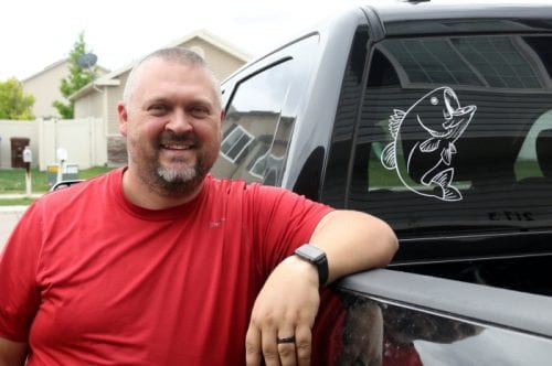 Vinyl Car Window Decal Sticker with Cricut Explore featured by top US craft blog, The Crafty Blog Stalker a man showing off his big mouth bass window decal on the back of his truck