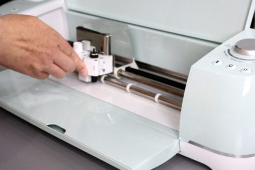 How to Install the Deep Cut Blade | Cricut Explore Products | Cricut Explore Air | Cricut Explore Air 2 | Craft Ideas | Electronic Cutter | DIY | Handmade | ad |  Cricut Deep Cut Blade by popular US craft blog, The Crafty Blog Stalker: image of a woman putting a deep cut blade in a Cricut Explore.