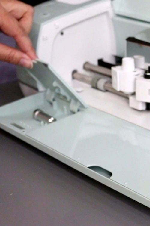 How to Install the Deep Cut Blade | Cricut Explore Products | Cricut Explore Air | Cricut Explore Air 2 | Craft Ideas | Electronic Cutter | DIY | Handmade | ad |Cricut Deep Cut Blade by popular US craft blog, The Crafty Blog Stalker: image of a woman putting a deep cut blade in a Cricut Explore.