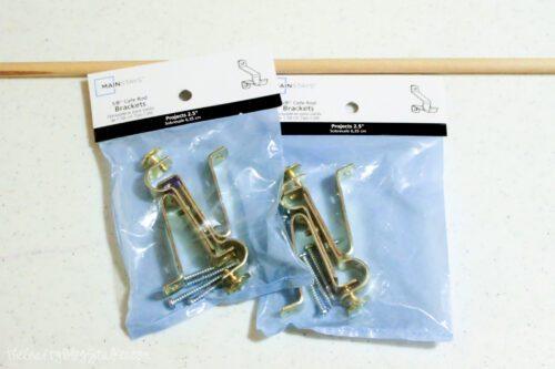 a wood dowel and gold cafe rod brackets