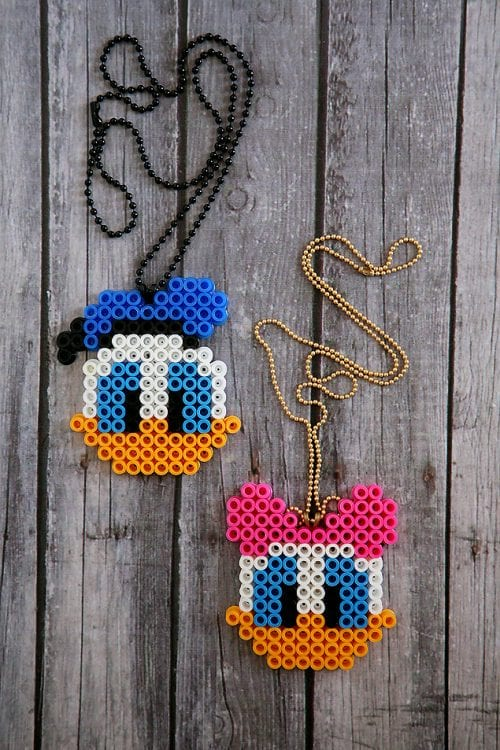 20 Fun Free Patterns for Perler Bead Crafts featured by top US craft blog, The Crafty Blog Stalker: Donald and Daisy Duck perler bead necklaces.