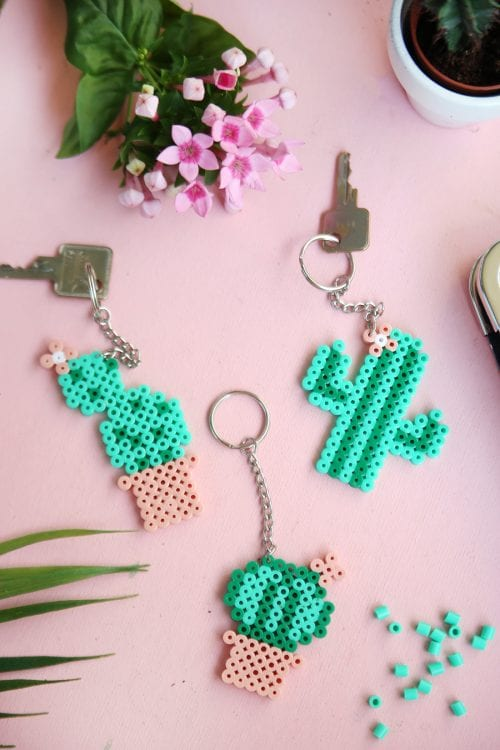 20 Fun Free Patterns for Perler Bead Crafts featured by top US craft blog, The Crafty Blog Stalker: cactus Perler bead key chains.