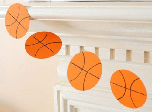 20 March Madness Party Ideas: Food, Games, and Decorations, featured by top US craft blog, The Crafty Blog Stalker: Paper Basketball Garland